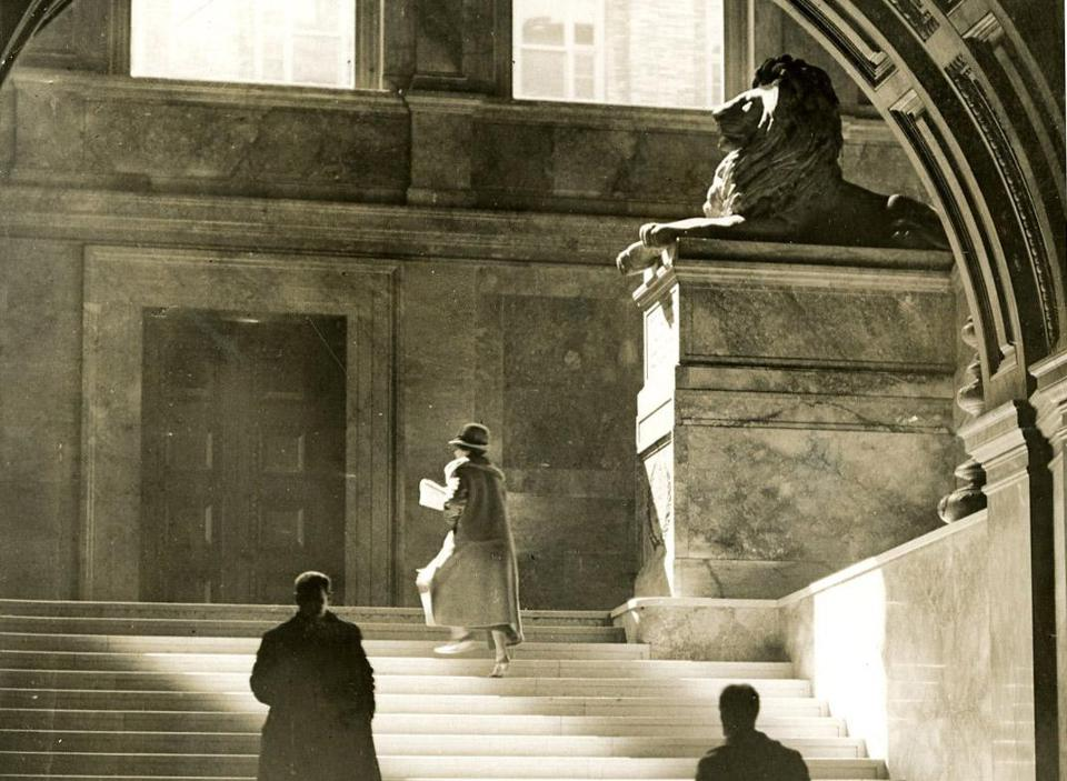 June 13, 1926: The play of light on the marble of the grand staircase lead one up to the twin lions on pedestals at the turn of the stairs. The lions were made from unpolished Siena marble by sculptor Louis Saint-Gaudens. They are memorials to the Second and Twentieth Massachusetts Civil War infantry regiments.